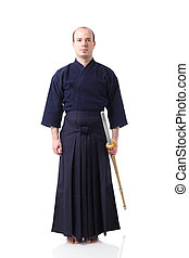 Kendo fighter with Shinai - portrait of a kendo fighter with...