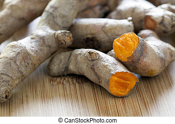 Fresh Turmeric Root - Turmeric root broken in half exposing...