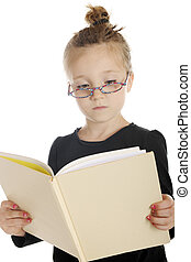 Studious Child - Close-up of a serious elementary girl...