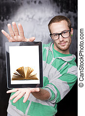 Digital library - Good Looking Young Nerd Smart Man Using Tablet Computer with book on screen