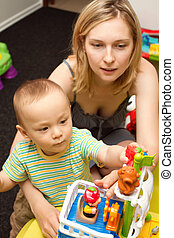 Baby And Mother Playing With The Toys - Cute baby boy and...