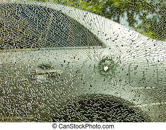Broken Car Glass - Insurance concept, broken car's glass...