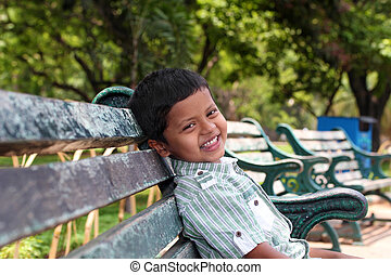 Young kindergarten school boy smiling & having fun