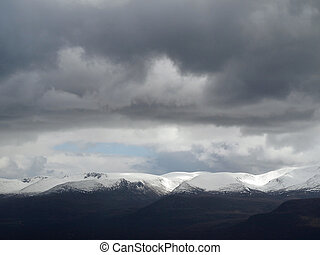 Very dark clouds over the Cairngorms summits, Scotland -...