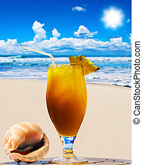 Tropical fruit cocktail and sea shell with ocean in background