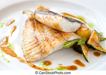 Grilled turbot fish with vegetables. - Close up of Grilled...
