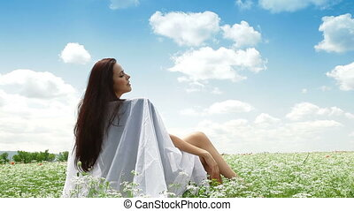 Young Woman Enjoying Summer Day In The Field
