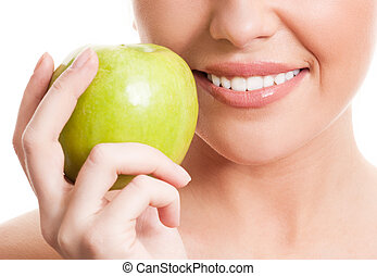 woman with an apple - closeup of the face of a woman holding...