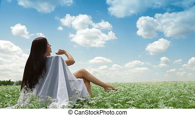 Relaxation Under Blue Sky - Attractive young woman sitting...