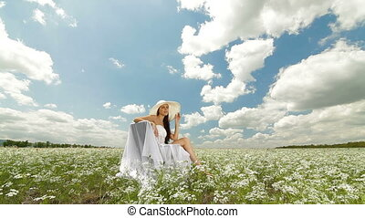 Young Woman On Field In Summer - A young woman in a white...