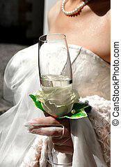 Bride with the glass of champagne