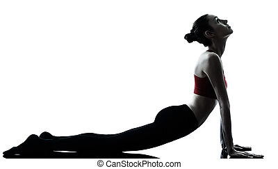woman exercising yoga sun salutation - one caucasian woman...