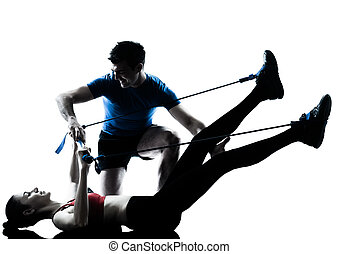 coach man woman exercising gymstick - personal trainer man...