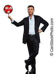 one business man playing juggling soccer ball - one...