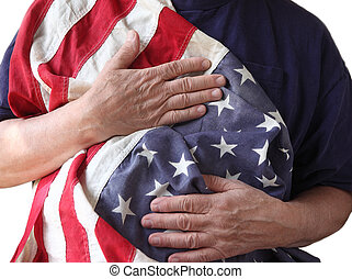 USA flag held by a veteran - a man holds the American flag...