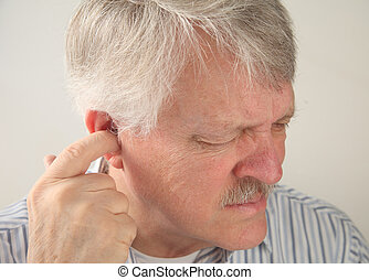 ear pain in a senior - an older man tries to relieve the...
