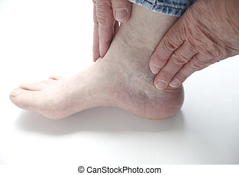 man with hands on ankle