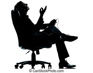 one business man listening music silhouette - one caucasian...
