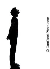one young teenager boy or girl silhouette - one caucasian...