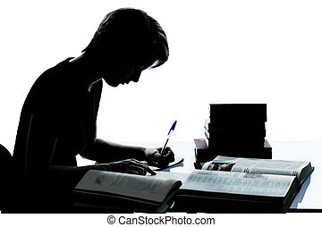 one caucasian young teenager silhouette boy or girl studying...