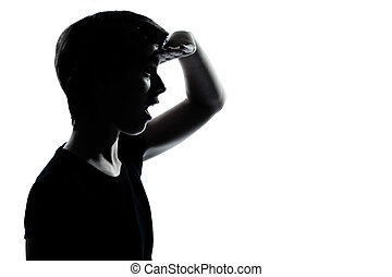 one young teenager boy or girl looking foward silhouette