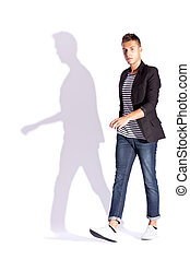 side view of a young casual fashion man  walking