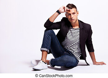 fashionable young casual man sitting
