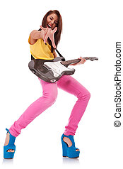 rock and roll baby! - picture of an energic girl playing a...