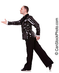 side view of a flashy male latino dancer in a pose on white...