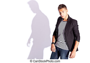 portrait of a young fashion man posing