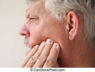 man with tooth or jaw pain - profile of a man suffering from...