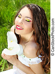 Virgin young woman with white flowers - Beautiful portrait of a tender woman on the nature. Wedding