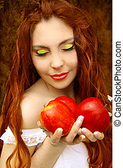Portrait of  young beautiful woman with red apples. Soft sunny colors.