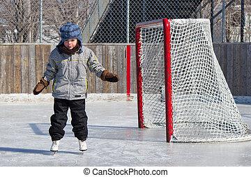 Little girl skating at an outdoor skating rink.