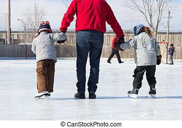 Family having fun at the skating rink - Family having fun at...