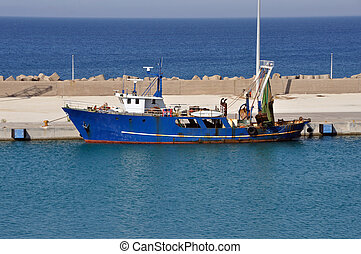 rusty fishing trawler - Fishing trawler in port. Rusty...