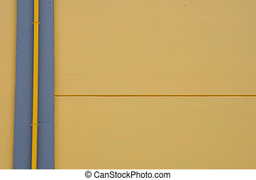 yellow wall and drain pipe background - Yellow wall and...