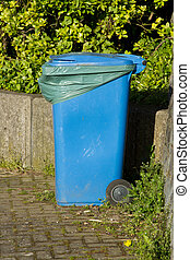 Blue bin. - A blue plastic wheely bin with closed lid and...
