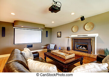 Living room with projector screen and fireplace. - Clasic...