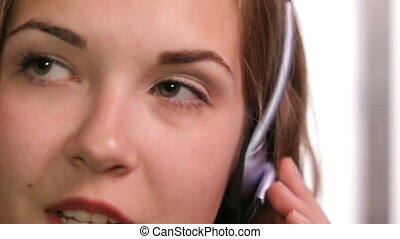 Call centre Close up - A girl working in a call centre White...