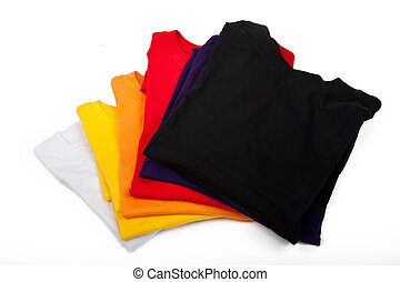 Stack of t-shirts - a stack of t-shirts isolated on white...