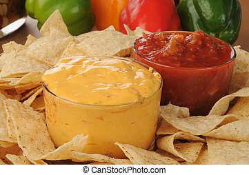 Party food - Close up of a tray of tortilla chips with salsa...
