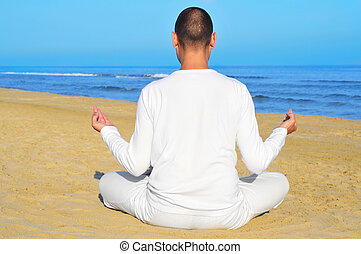 meditation - someone meditating on the beach