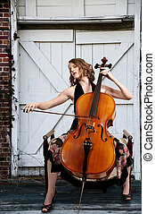 Woman cellist - Beautiful woman cellist with her cello...