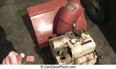 Pouring Gas into Machine - Guy pouring gas into snowblower...