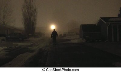 Alley Man Approaching in Fog - Unidentifiable, dark dressed...