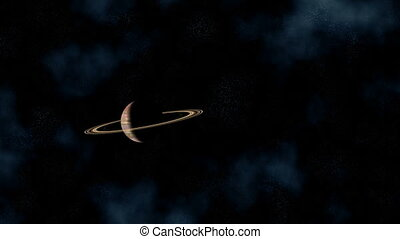 Saturn - The planet environed with rings slowly flies...