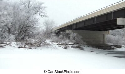 Frozen Bridge & Trees in Winter - Shot of bridge over frozen...