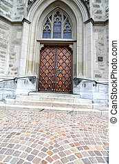 Massive wooden door in church