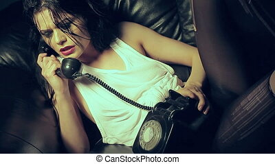 Woman in tears on a telephone - Young trendy woman lying on...
